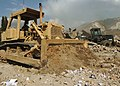 US Navy 051102-N-1261P-036 Seabees assigned to Naval Mobile Construction Battalion Seven Four (NMCB-74) and a Pakistani engineering company work together to clear debris caused by the earthquake in Muzaffarabad, Pakistan.jpg