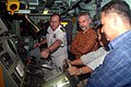 US Navy 060626-N-4124C-073 Commanding Officer USS Patriot (MCM 7), Lt. Cmdr. Richard D. Brawley discusses elements of the ship's command console to U.S. ambassador to Brunei, the Honorable Emil Skodon, and senior officers of th.jpg