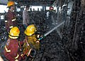 US Navy 070212-N-9860Y-751 Members of the rescue and assistance team aboard amphibious command ship USS Blue Ridge (LCC 19) work with Cebu's Filipino-Chinese Volunteer Fire Brigade in an attempt to help the passenger ferr.jpg