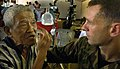 US Navy 070219-N-8977L-138 Maj. Steven Clancy, of Canton, Ohio, screens a patient's eye for prescription glasses during the Medical Civic Action Program (MEDCAP) portion of Exercise Balikatan 2007.jpg
