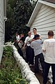 US Navy 070824-N-0606B-008 Sailors form a chain as they place sandbags around local homes in an attempt to preserve the property of local homeowners.jpg