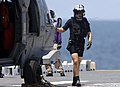 US Navy 070906-N-1810F-217 Aviation Warfare Systems Operator Airman Michael Gionet, search and rescue swimmer, performs last minute inspections before embarking on a mission aboard an MH-60S Seahawk.jpg