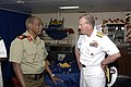 US Navy 071215-F-0509T-016 Rear Adm. James Hart, commander, Combined Joint Task Force-Horn of Africa, and Djiboutian Army Brig. Gen. Osman Soubagleh, director of international relations, meet for a reception at end the Operatio.jpg