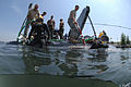 US Navy 080607-N-5329L-076 Navy Divers enter the Providence River to begin diving operations on the wreck of the former Soviet submarine Juliett 484.jpg