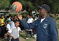 US Navy 080709-N-1159B-095 Boatswain's Mate 1st Class Andre Batts, assigned to the amphibious dock landing ship USS Toruga (LSD-46), demonstrates proper ball spinning technique during a community relations project.jpg