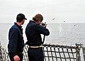 US Navy 080729-N-1488S-009 unner's Mate 2nd Class Richard Slade teaches Midshipman 3rd Class Elizabeth Subjeck how to fire an M-16 rifle.jpg