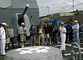 US Navy 080731-N-4649C-003 Ensign Samantha Foxton describes the ship's anchor assembly to a tour group on the ship's foc'scle.jpg