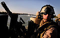 US Navy 081127-N-5549O-096 Construction Mechanic 2nd Class David Jellison, assigned to Riverine Squadron 1, mans a GAU 17 machine gun aboard a riverine assault boat while patroling the Euphrates River.jpg