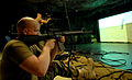 US Navy 090121-N-3674H-052 Steelworker 3rd Class Benjamin Nablo, assigned to Naval Mobile Construction Battalion (NMCB) 74, fires his M16 rifle during firearms training using a fire arms training simulator.jpg