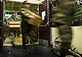 US Navy 090307-F-3646G-045 Sailors and soldiers carry medical supplies from the gymnasium of the Alaska Army National Guard Armory in Bethel in preparation to deploy in support of the 15th annual Operation Arctic Care.jpg