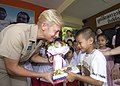 US Navy 090714-N-6770T-132 Rear Adm. Nora Tyson, commander, Logistics Group Western Pacific, exchanges gifts with a child at the Pattaya Orphanage.jpg
