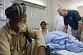 US Navy 090809-N-5549O-098 Secretary of the Navy (SECNAV) the Honorable Ray Mabus speaks to an Afghan girl while touring a hospital at Camp Bastion, Afghanistan.jpg