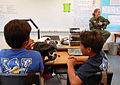 US Navy 091021-N-0535P-022 Naval Air Crewman 2nd Class Mehgan Rodriguez, assigned to Pacific Missile Range Facility, Kauai, Hawaii, describes her duties and experiences in the Navy during a career fair at Waimea Canyon Middle S.jpg