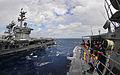 US Navy 100304-N-4774B-221 Sailors standing the bridge watch aboard the guided-missile cruiser USS Bunker Hill (CG 52) observe their approach towards the Nimitz-class aircraft carrier USS Carl Vinson (CVN 70).jpg