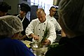 US Navy 100419-N-7163S-002 Chief Navy Counselor Joseph Kacinski, assigned to Navy Recruiting District Minneapolis, shows students at the Central Campus High School culinary arts program how to make pineapple-mango salsa.jpg