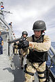 US Navy 100623-N-7638K-400 Yeoman 3rd Class Jeremy Tenney, assigned to the Oliver Hazard Perry-class frigate USS Taylor (FFG 50), acts as rear security after a visit, board, search and seizure team.jpg