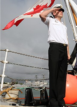 US Navy 100701-N-8539M-013 Leading Seaman Richard Glasbergen, from Grimsby, Ontario, raises the Canadian flag aboard the Royal Canadian Navy destroyer HMCS Algonquin (DDG 283) during the morning colors ceremony for Canada Day