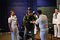 US Navy 100906-N-0869H-032 KTVI Fox-2 television personality Tim Ezell wears a bomb suit used by Explosive Ordnance Disposal Operational Support Unit Detachment 10.jpg