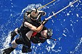 US Navy 100914-N-7293M-042 Lt. j.g. Daniel Cooper and search and rescue swimmer Seaman Apprentice Ryan Owens take turns rescuing an injured swimmer.jpg