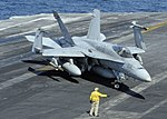 US Navy 101114-N-6427M-074 A plane director guides the pilot of an F-A-18C Hornet as it taxis across the flight deck aboard the aircraft carrier US.jpg