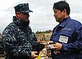 US Navy 110404-N-8607R-023 Rear Adm. Jeffrey S. Jones speaks with a resident of Oshima, to discuss the progress of disaster relief operations.jpg