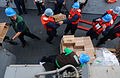 US Navy 110707-N-TB177-127 Sailors move supplies during a connected replenishment aboard the guided-missile destroyer USS Truxtun (DDG 103).jpg