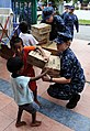 US Navy 110905-N-ZY850-045 Sailors assigned to the John C. Stennis Carrier Strike Group hand out medical supplies to members of the Juara Boys' Hou.jpg