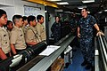 US Navy 110923-N-CB621-048 Electronics Technician 1st Class Joseph Patterson, right, guides Navy Junior ROTC cadets from Father Duenas Memorial Sch.jpg