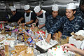 US Navy 111216-N-UE944-005 Sailors participate in a gingerbread house-building contest sponsored by the morale, welfare, and recreation department.jpg
