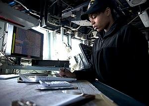 US Navy 120131-N-NL401-194 Quartermaster Seaman Adriana M. Scott plots the ship's position.jpg