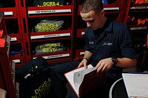 US Navy 120202-N-GZ832-025 Damage Controlman Fireman Cameron Michalak inventories a pipe patching kit in a repair locker aboard the Nimitz-class ai.jpg