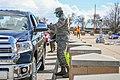 US airman providing curbside service during the coronavirus pandemic in 2020.jpg