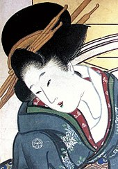 A finely-dressed Japanese woman wearing a kimono with a crest on the shoulder