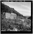 VIEW OF CONCRETE BUILDING RUINS AND RETAINING WALL, LOOKING EAST - Winter Quarters Mine, Scofield, Carbon County, UT HAER UTAH,4-SCOF,2-9.tif