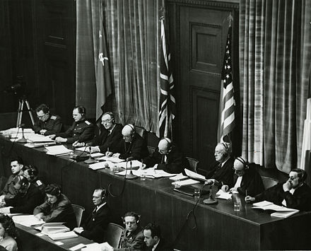 Judges sitting in Nuremberg, from left to right: Volchkov, Nikitchenko, Birkett, Sir Geoffrey Lawrence, Biddle, Parker, Donnedieu de Vabres and Falco View of judges panel during testimony Nuremberg Trials 1945.jpeg