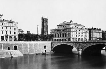 View of the Pont au Change and the buildings on Place du Chatelet, with the Tour Saint-Jacques in the background.jpg