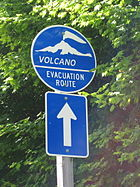 One of many emergency evacuation route signs in case of volcanic eruption or lahar around Mt. Rainier.
