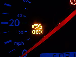 "Check engine light - A MIL ""Check Engine"" light on a Volkswagen Bora indicating a fault in the Engine Management System."