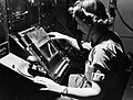 WAAF radar operator Denise Miley plotting aircraft on a cathode ray tube in the Receiver Room at Bawdsey 'Chain Home' station, May 1945. CH15332.jpg