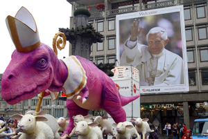 A sculpture of a dinosaur and sheeps (10 meter...