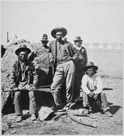 Warm Spring scouts, Lava Beds, California, their leader, Donald McKay, is leaning against rock, 1873 - NARA - 533246