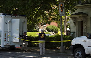 Two FBI agents outside 39 Waverley Avenue in W...