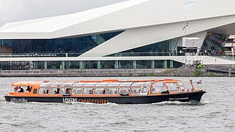 Boats give tours of the city, such as this one in front of the EYE Film Institute Netherlands. Wim Sonneveld tour boat, Rederij Lovers, Amsterdam-9218.jpg