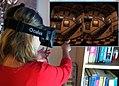 Woman in Oculus Rift DemoWorld 2013.jpg