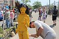 Yellow body paint 02 at Coney Island Mermaid Parade 2013.jpg