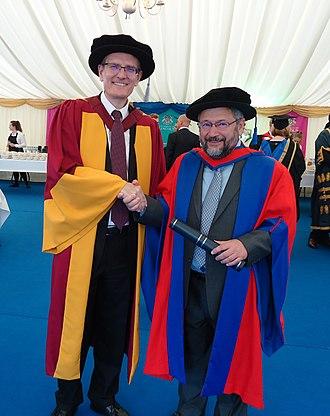 Efim Zelmanov - Efim Zelmanov (right) with the University of Lincoln (UK) Deputy Vice-Chancellor Professor Andrew Hunter (left) after receiving Honorary DSc degree. 5th September 2016, Lincoln, UK.