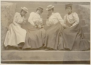 "Clark Atlanta University - ""Four African American women seated on steps of building at Atlanta University, Georgia"", ca. 1900."