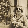 (Madge Elliott having a drink in a garden) (cropped).jpg