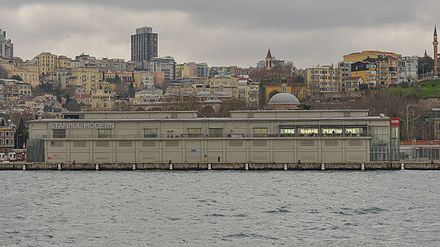 The former building of Istanbul Modern, a museum of contemporary art on the Bosphorus, is currently being replaced by a new one designed by Italian architect Renzo Piano. The new building is a component of the Galataport project for the renovation of the port of Istanbul. İstanbul Modern February 2013.jpg