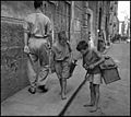 """Children In Naples, Italy"". Little boys at work. Photographed by Lieutenant Wayne Miller, July 1944. U.S. Navy Photograph, now in the collections of the National Archives.jpg"